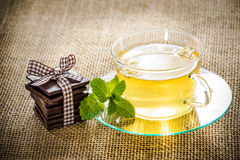 Glass tea cup mint leaves and chocolate. Stock Photography