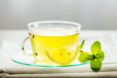 Glass tea cup mint leaves. Stock Photography
