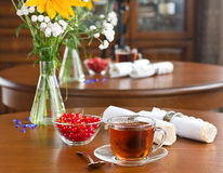 Glass tea cup on wooden table Royalty Free Stock Photography