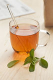 Glass with tea and fresh stevia leaves Royalty Free Stock Photography