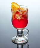 Glass of tea with fruits and syrup Royalty Free Stock Photography