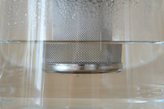 Glass tea kettle closeup Stock Photo