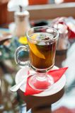 Glass of tea with lemon, cinnamon sticks, anise star and mint  mint leaves Stock Image