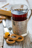 Glass of tea in an old cup holder. Royalty Free Stock Photos