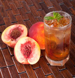 Glass of tea with peach Stock Photo
