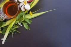 1 glass of tea placed in various flowers on the black table stock photography