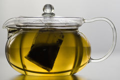 Glass tea pot with tea bag Stock Photo