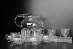 Glass tea set, black and white image Royalty Free Stock Images