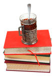 Glass of tea on stack of books Royalty Free Stock Photo