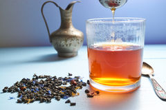 Glass of tea with tea strainer out Royalty Free Stock Image