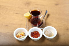 A glass of tea. Turkish traditional tea with sweet snacks Royalty Free Stock Photography