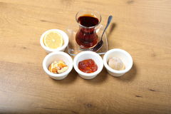 A glass of tea. Turkish traditional tea with sweet snacks Royalty Free Stock Images