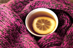 A glass of tea and warm scarf Stock Image