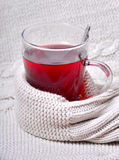 A glass of tea with warm wool Royalty Free Stock Image