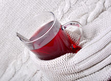 A glass of tea with warm wool Stock Images