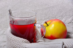 A glass of tea with warm wool Stock Image