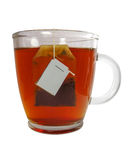 Glass teacup with teabag Royalty Free Stock Images