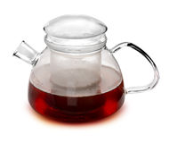 Glass Teapot. Modern glass teapot filled with hot tea royalty free stock images