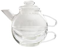 Glass teapot. With cup on a white background stock photo
