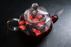 Glass teapot background organic fruit tea concept Stock Photo