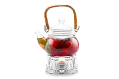 Glass teapot with berry tea Royalty Free Stock Image