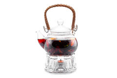 Glass teapot with berry tea Stock Images