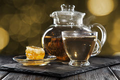 Glass teapot on black Royalty Free Stock Image