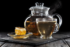 Glass teapot on black Stock Photos