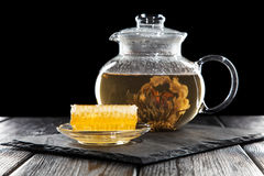Glass teapot on black Stock Images