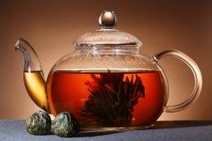 Glass teapot. With black tea stock photo
