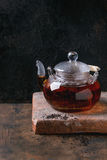 Glass teapot with black tea Stock Photo