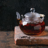 Glass teapot with black tea Royalty Free Stock Photos