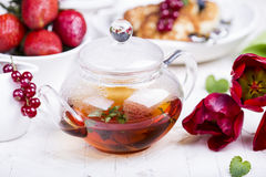 Glass teapot with black tea Royalty Free Stock Photography