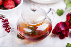 Glass teapot with black tea Royalty Free Stock Images