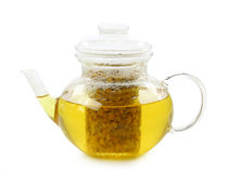 Glass teapot with camomile tea Stock Photos