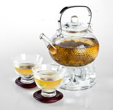 Glass teapot Chinese tea. On the white stock image