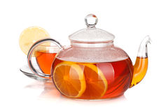 Glass teapot and cup of black tea with lemon. Isolated on white background Stock Photos