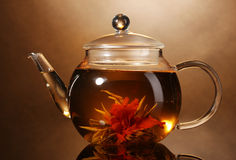 Glass teapot and cup with exotic green tea Stock Images