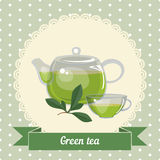 Glass teapot and cup with green tea Stock Photos