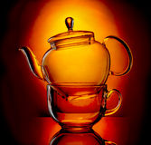 Glass teapot and cup Royalty Free Stock Images