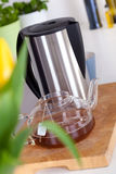 Teapot and electric kettle on a kitchen counter Royalty Free Stock Images