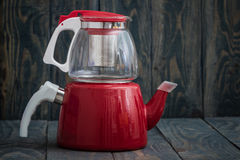 Glass Teapot and Enamel Kettle Stock Photography