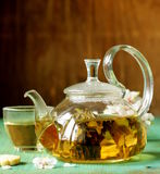 Glass teapot with exotic green tea Royalty Free Stock Photos