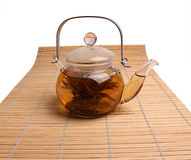 Glass teapot with green tea Royalty Free Stock Photography