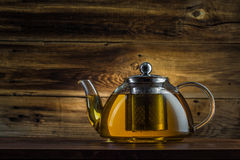 Glass teapot with green tea Royalty Free Stock Images