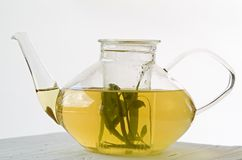 Glass Teapot with Herbal Tea Stock Photography