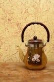 Glass teapot with herbal tea Stock Photos