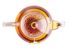 Glass teapot of hot black tea. On white background Royalty Free Stock Image