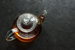 Glass teapot with hot tea Royalty Free Stock Photos