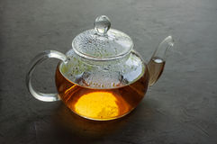 Glass teapot with hot tea Royalty Free Stock Photography